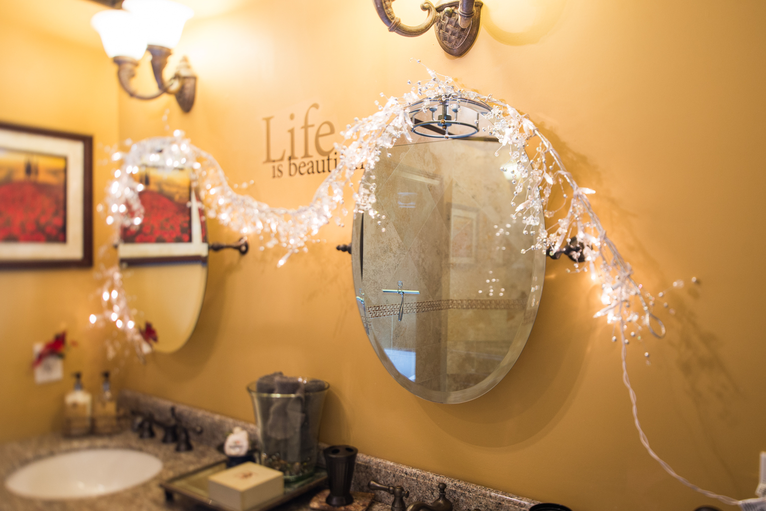 2 mirrors on a wall in bathroom
