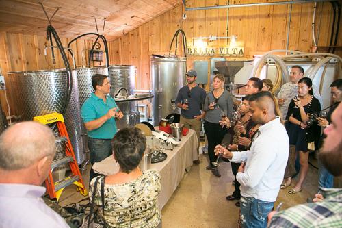 winemaker talking to people inside tasting room