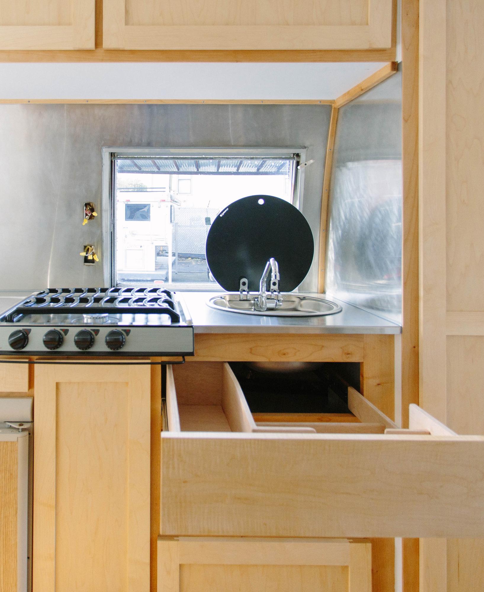 DESIGN - Re-create original layoutMaple hardwood cabinets & warm wood floorLight & bright wallsDesign forward dinette that is convertible into sleeping areaOriginal bathtub & surround fiberglass repair, restoration & painting