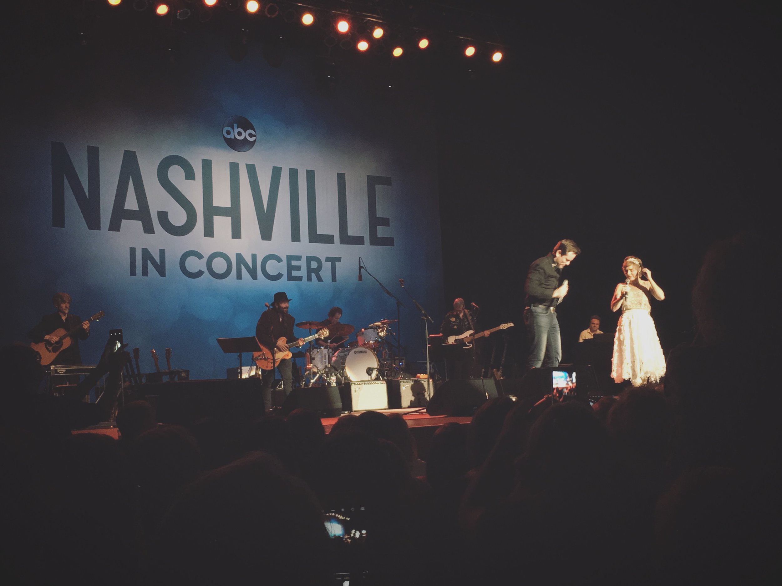 Charles Esten (who plays Deacon Claybourne) and Clare Bowen (who plays Scarlett O'Connor) sing and dance on stage during a duet.   (Photo credit: Reagan Fleming)