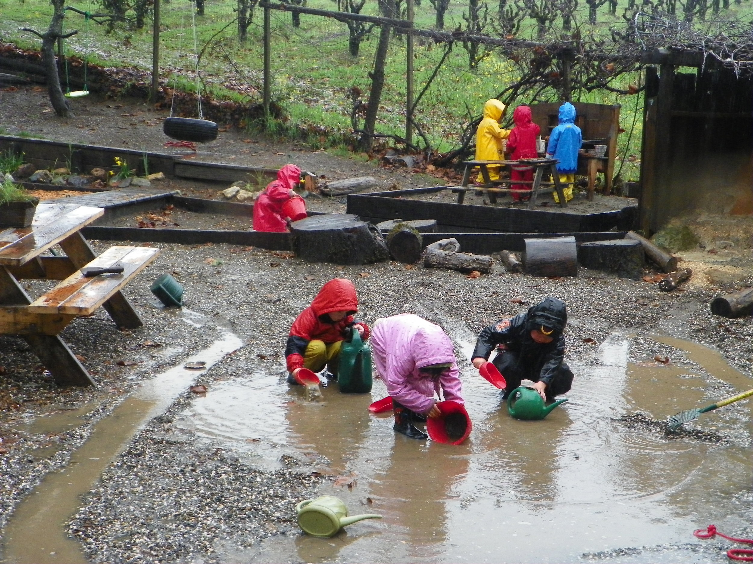 Child play outdoors year round, rain or shine.
