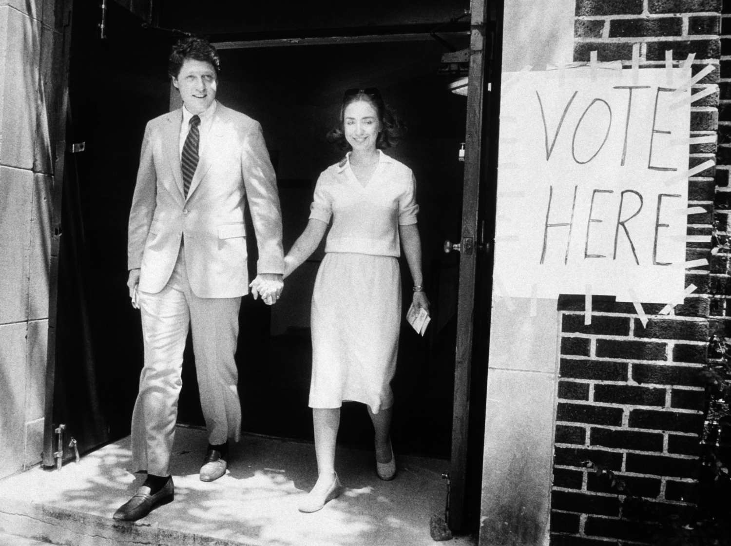 A young Arkansas couple leave the polling station having voted in the 1982 gubernatorial election.