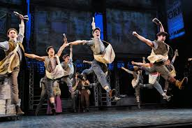 Newsies was a 1992 film by Disney starring a young Christian Bale. It's been turned into a Broadway musical with dance numbers that rival  Seven Brides for Seven Brothers  for sheer athleticism.
