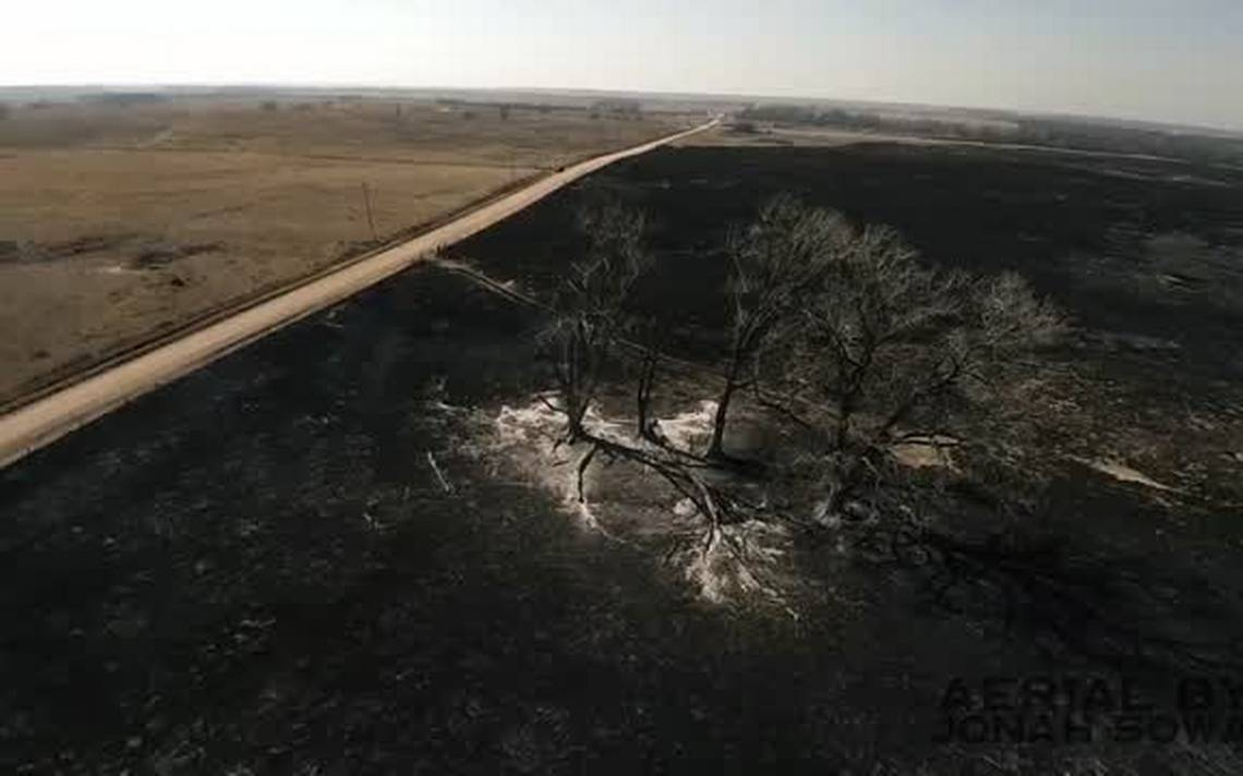 """Photo from Wichita Eagle with one more headline I read when I woke up on March 28, 2017:  """"More extreme weather could mean more, bigger wildfires, scientists say.""""  The dividing line in this photo evoked a passage from Deuteronomy 30-- """"This day I call the heavens and the earth as witnesses against you that I have set before you life and death, blessings and curses.Now choose life, so that you and your children may live and that you may love the Lord your God, listen to his voice, and hold fast to him"""" (30:19-20)."""