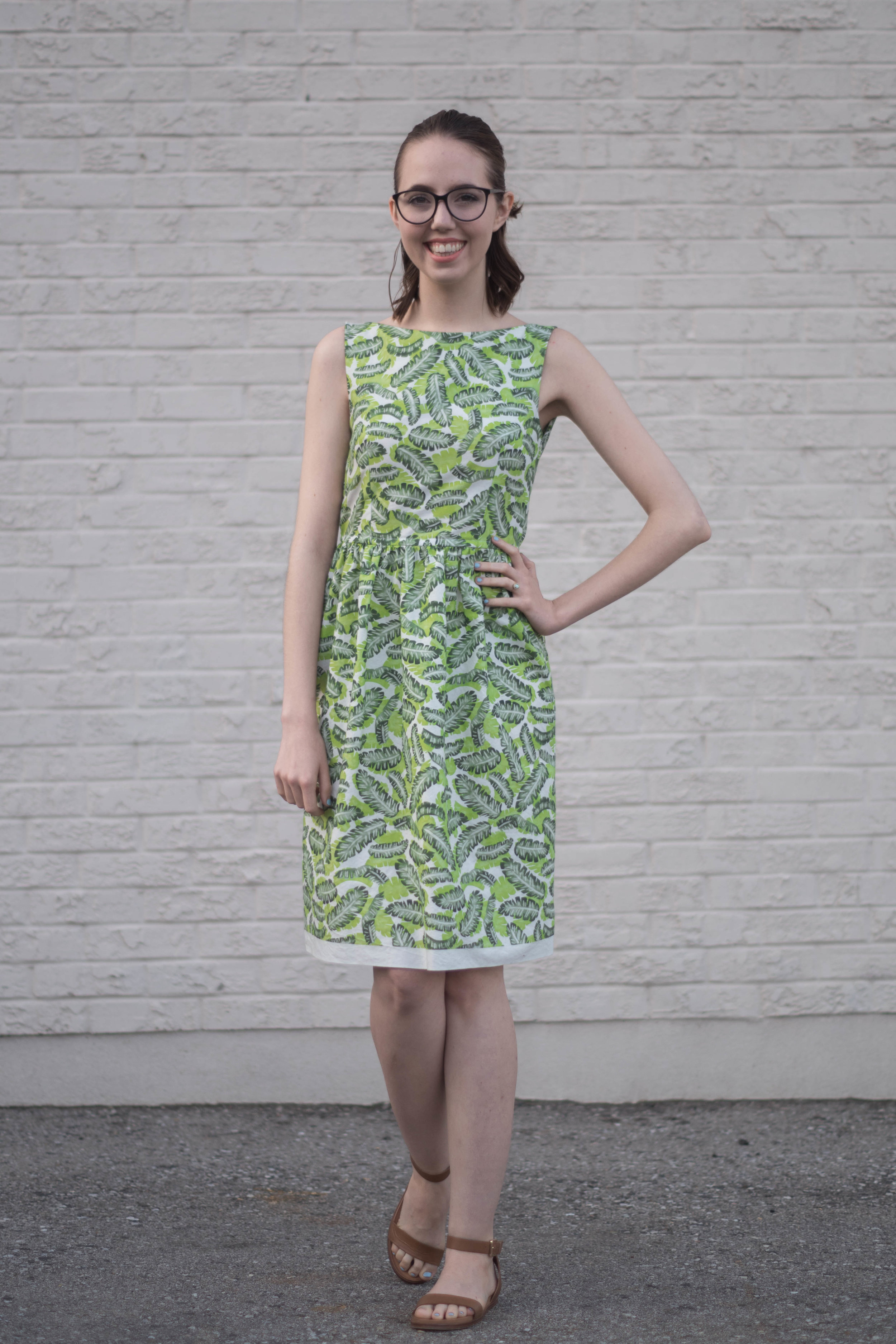 This dress was sewn up using a FREE pattern! Click through to find out how to sew your own tropical summer dress.