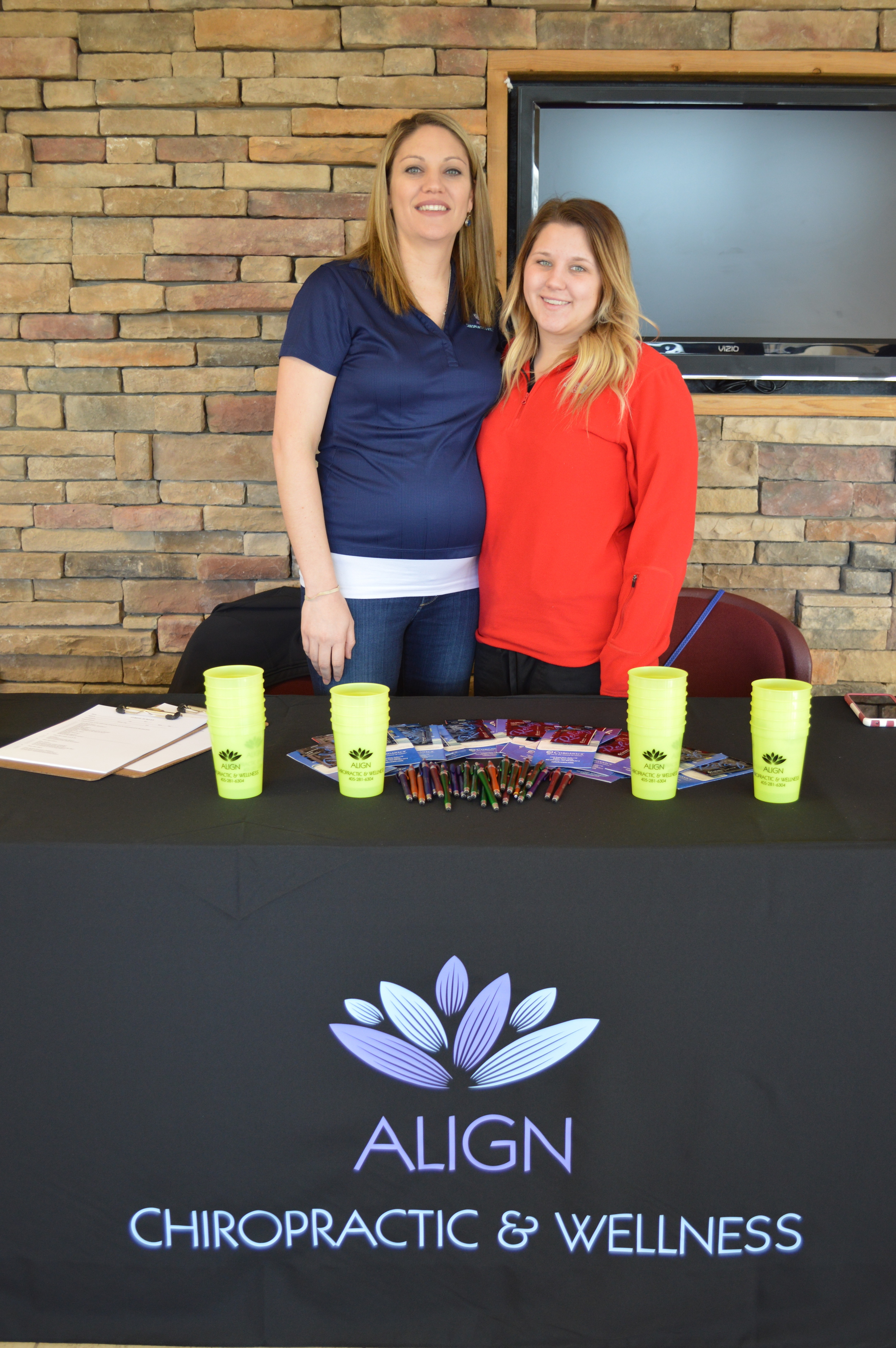 Dr. Tara Goodson (right) and Kendal Wyatt (left) talk to seniors about how chiropractic services can help ease the pains of aging. Align Chiropractic and Wellness was voted Best Chiropractic in Choctaw for the second year in a row.