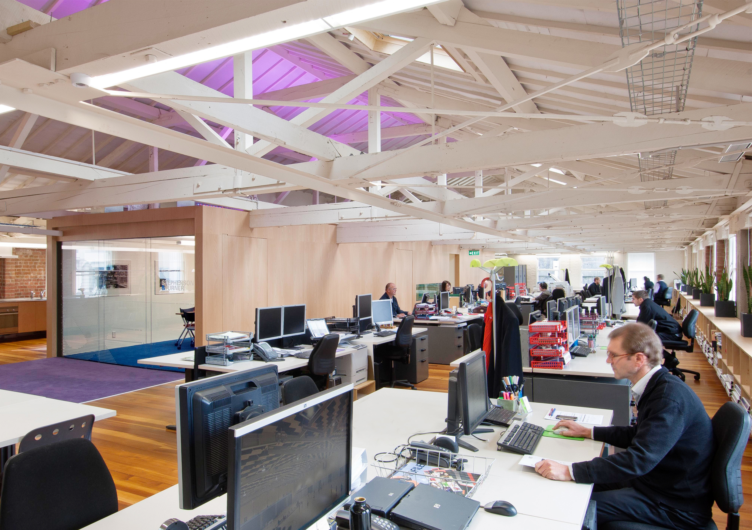 "Stephenson & Turner     Design Studio, Wellington   S&T recently completed fitting out the top floor of a 110 year old building for the new Wellington office. Timber floors, exposed brick walls and open trusses offered huge potential to create an open plan office that speaks to our firm's core philosophy of ""creating inspirational environments."""