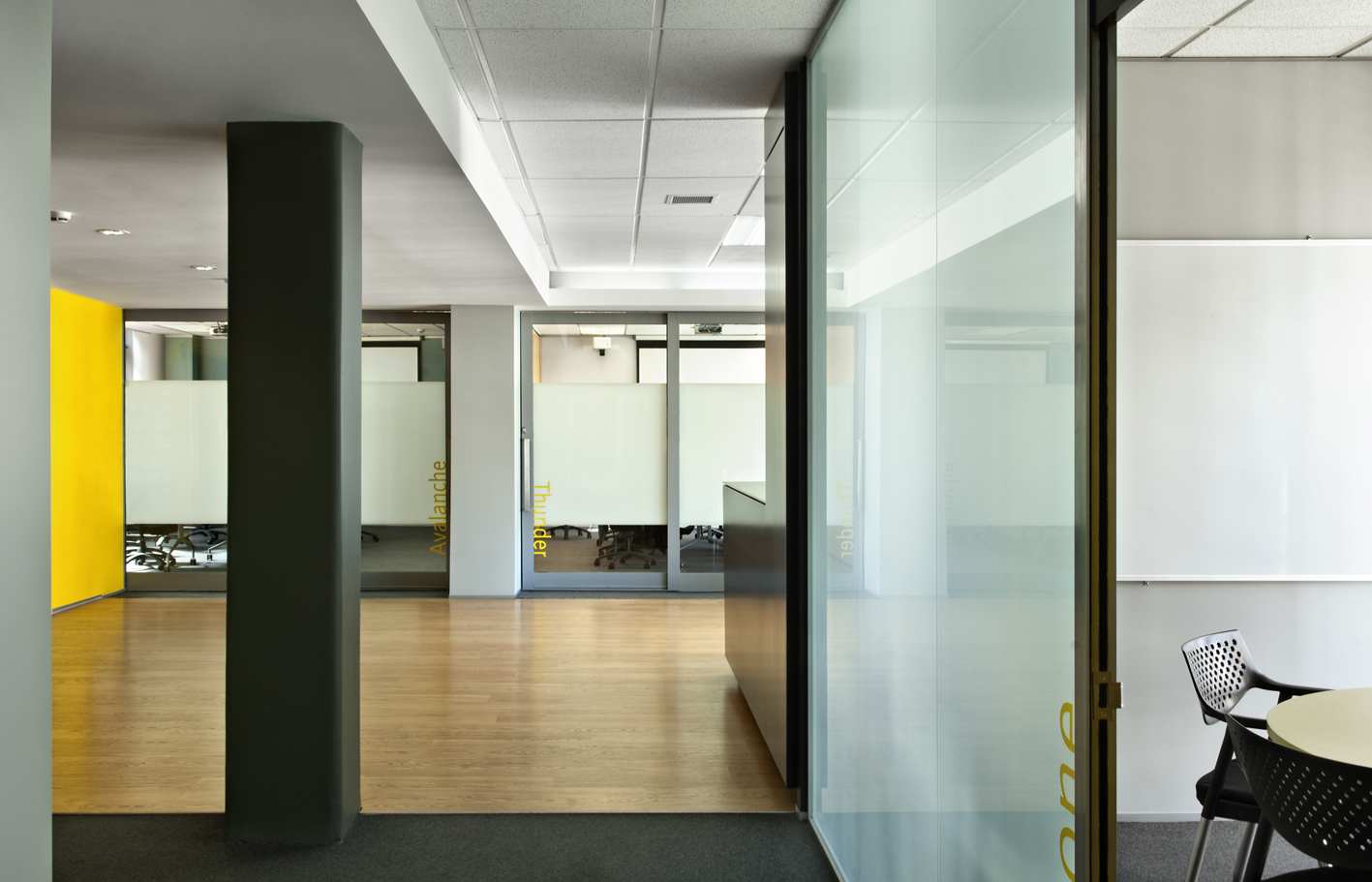 "Intergen     Office Fitout   S&T created a fresh new office for IT company, Intergen. The company's extension onto a third floor included a 900-square-metre fitout which reflects the company's brand. The vibrant ""Intergen Yellow"" was included on feature walls and screen dividers and was complemented elsewhere with neutral off-whites and greys."