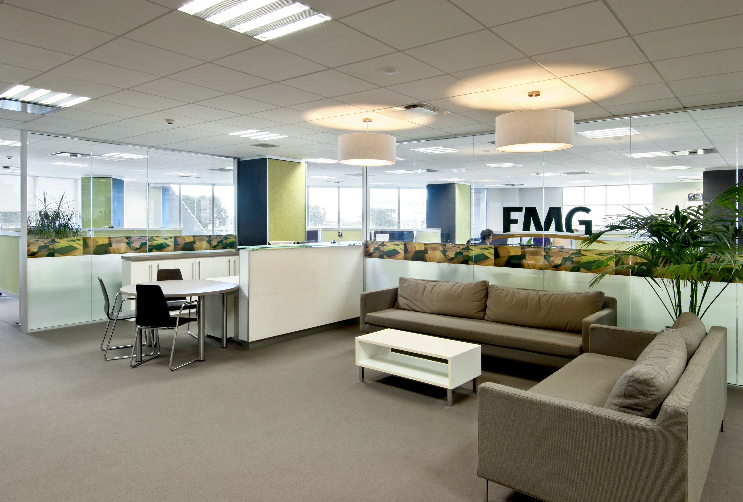 FMG     Headquarters Fitout   Following on from FMG's Corporate Office in Wellington, S&T were asked to refurbish their Head Office in Palmerston North where they had been based for a number of years in a building famous for it's 'crystaline' shape. This presented unique challenges but resulted in a polished interior design.