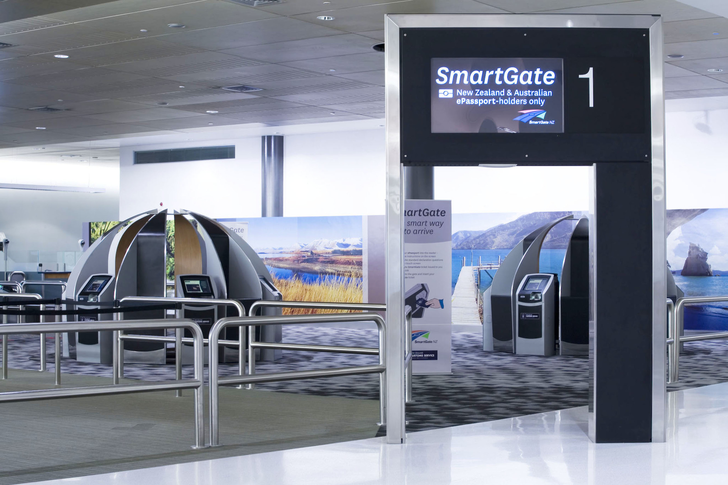Auckland International Airport   Smart Gate   S&T's design included the installation of the country's first automated border processing system. Developed by NZ's Customs Service, 'Smart Gate' processes passengers arriving in Australia or New Zealand.