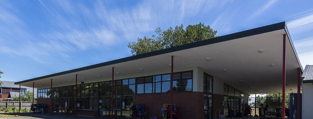 The mono-pitched roof extends to prevent overheating and also provides a covered outdoor learning space.
