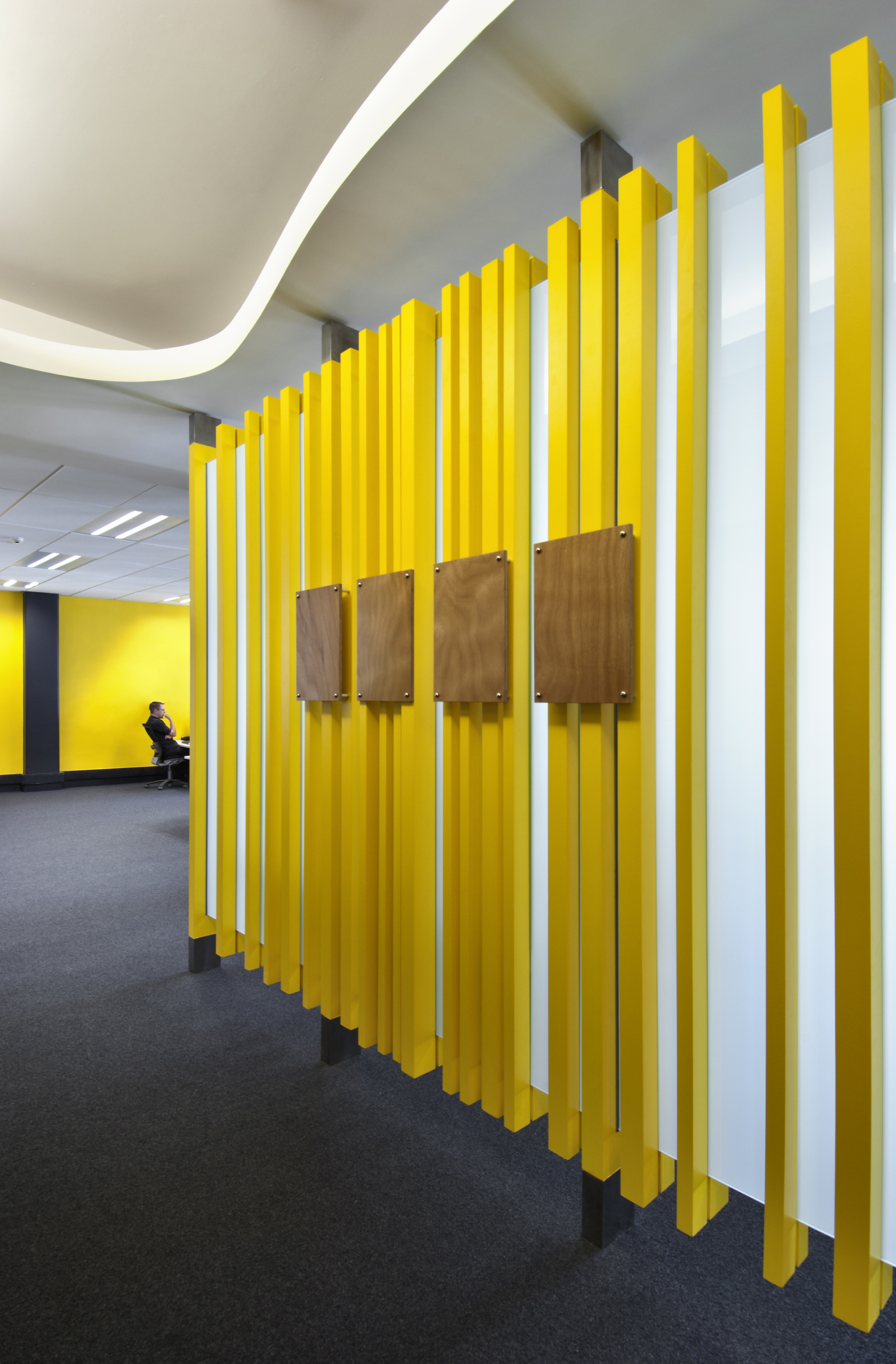 "Intergen -   Office Fitout   S&T created a fresh new office for IT company, Intergen. The vibrant ""Intergen Yellow"" has been incorporated into the design through feature walls and screen dividers."