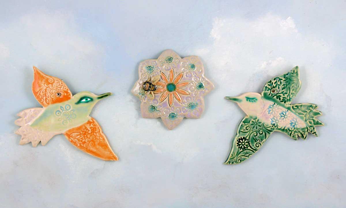 Porcelain hummingbirds and flower medallion. Cathy Kiffney Studio