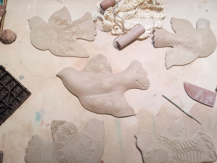making and texturing porcelain wall birds.