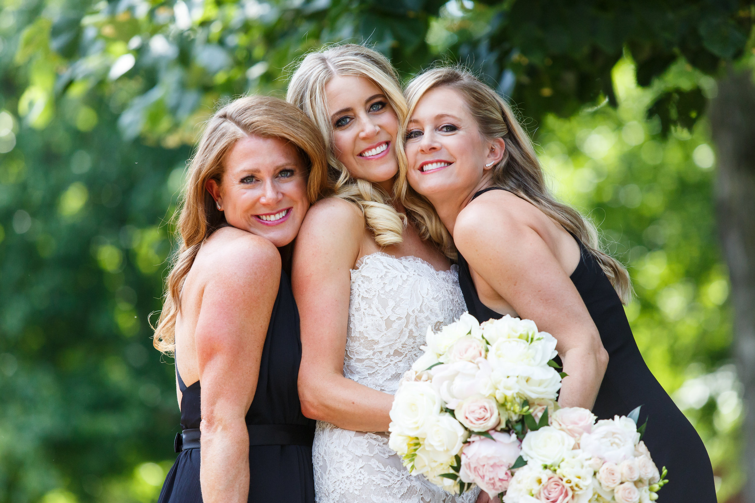 I absolutely love this picture of the bride and her two sisters!