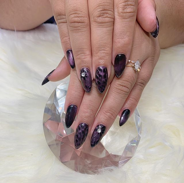Stiletto cat eyes gel nails!😻get your cattiness on only at sky nails #purrfect