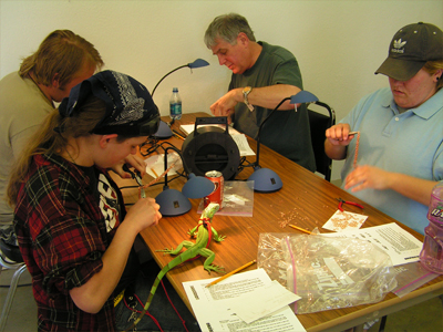 Students participate in Rob Glover's jewelry workshop