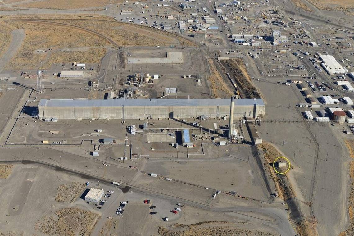 An aerial view of the PUREX processing plant shows the building, circled in yellow, where steam was observed Friday morning. The building is at the start of a 1,700-foot long waste storage tunnel. Beside it is a shorter waste storage tunnel where a partial collapse occurred in May 2017.  Courtesy Department of Energy