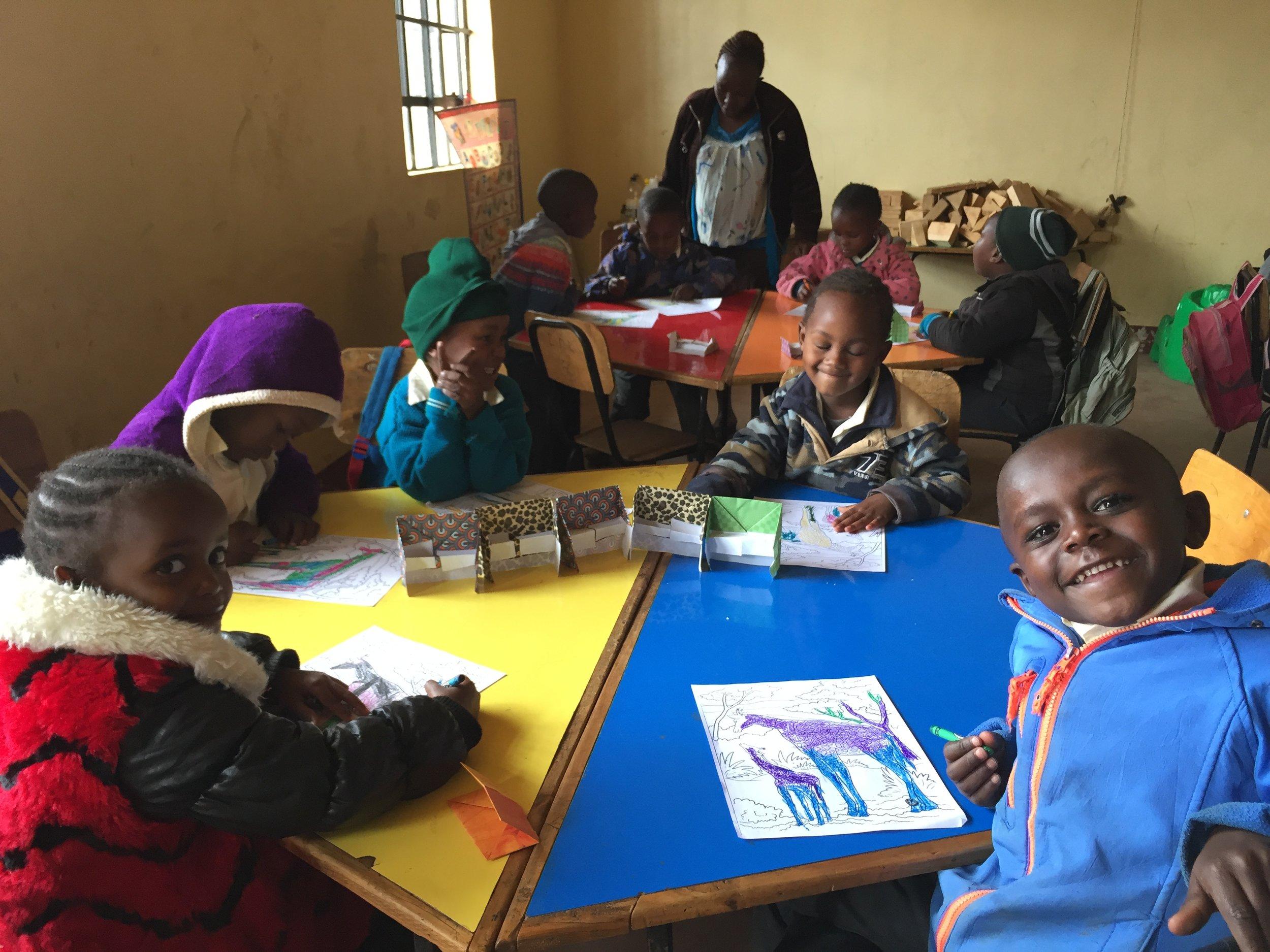 Children doing crafts at Living Positive Kenya