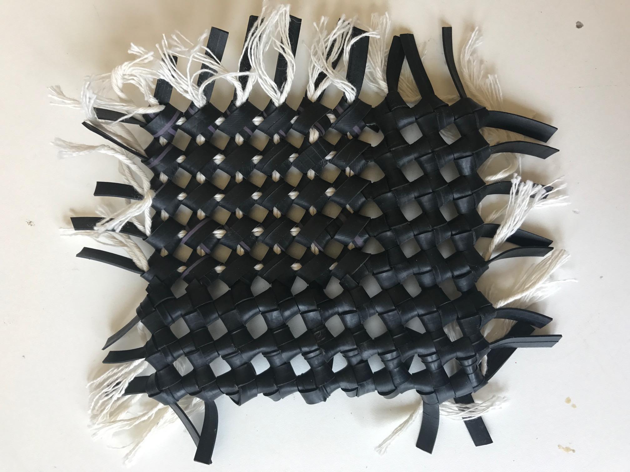 A sample of the same knotting technique but with the reverse showing in one section which also gave the fabric more dimension.