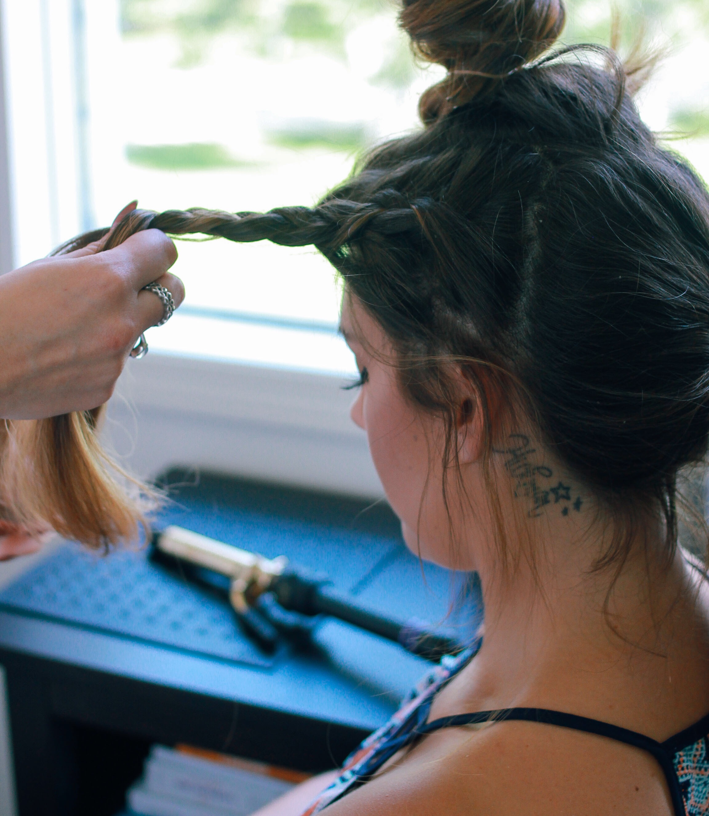 Use three strand technique. Braid in the direction you want to go. Finish braid and secure with hair tie.