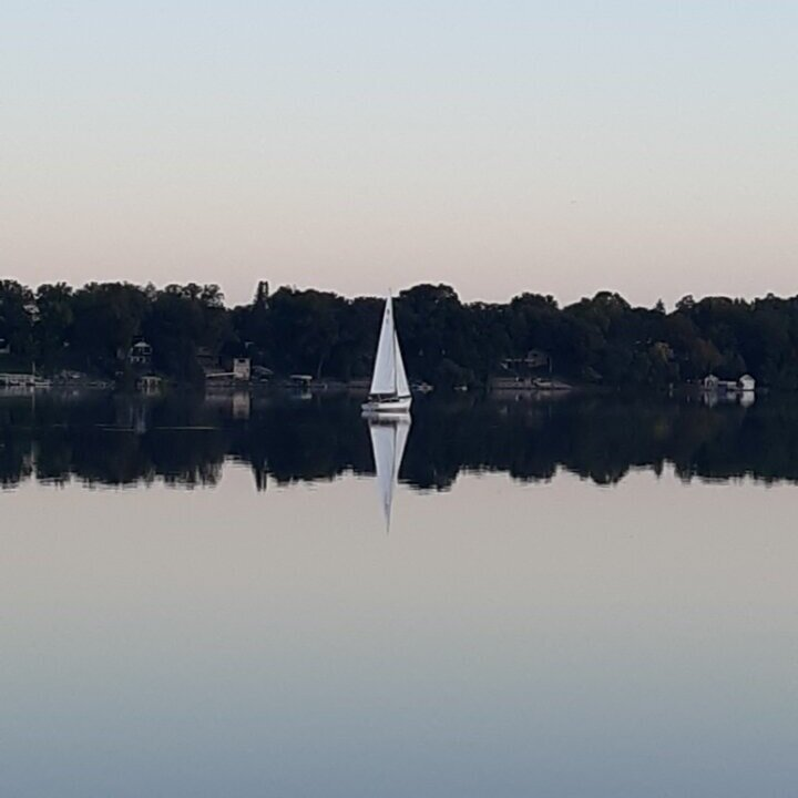 """Stan P's early morning """"sail"""" to the boat ramp to haul his Rhodes 19 after sailing for the 28th season near Alexandria, MN."""