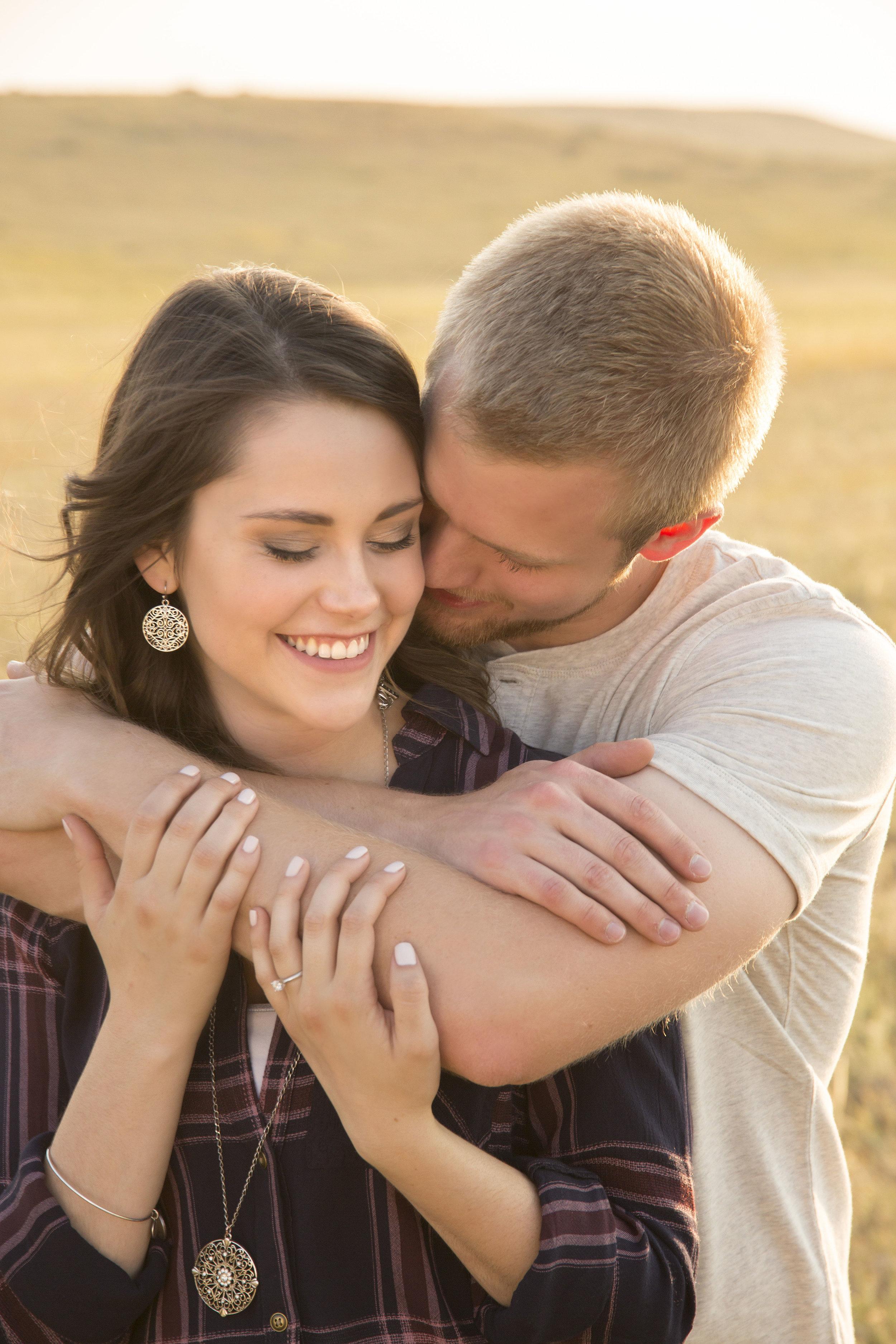 Engagement photo in pasture