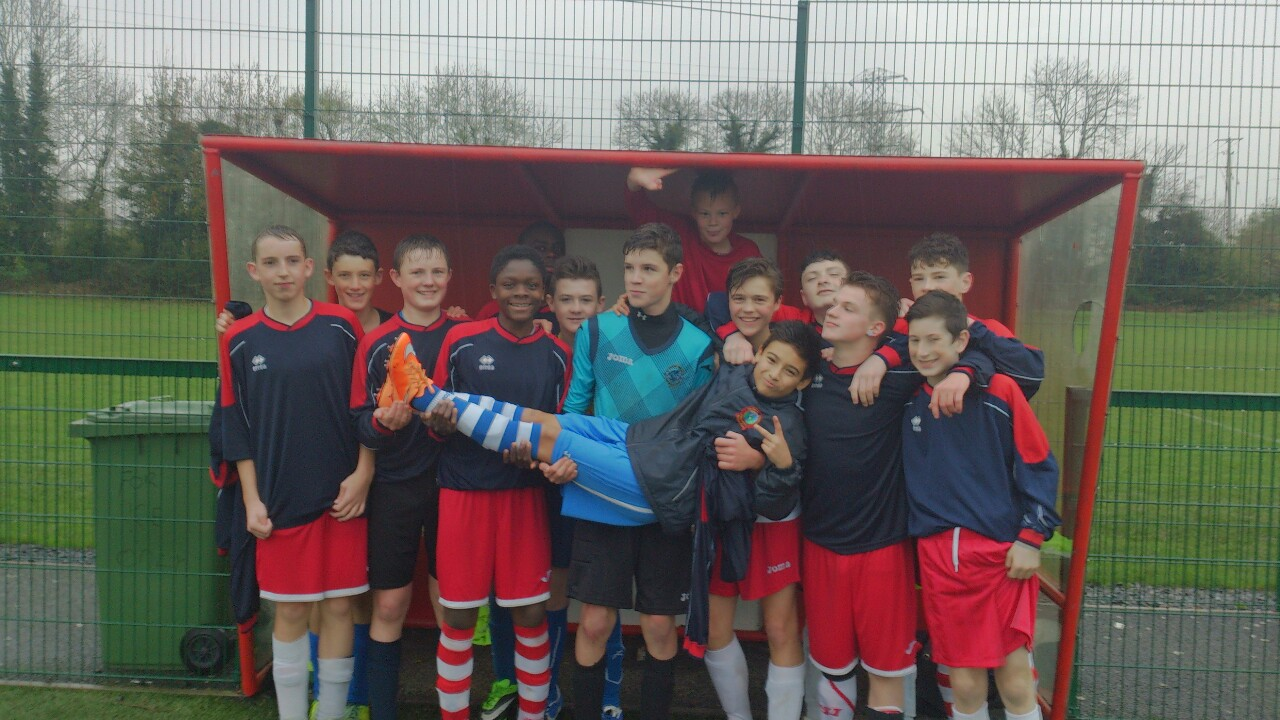 Singin' in the Rain!    The U15 Boys' soccer team celebrate following their epic 2-1 victory over Ashbourne C.C. this afternoon.    This was a 'must win' game for the lads. Played in desperate conditions, we were gifted a fortunate lead early on. However Ashbourne were resurgent and soon it wasn't only the clouds that were looking ominous! Level at the interval, CC started the second half brightly, pouring scorn on nature's disfavour and then took the lead from a coolly-converted Kyle Costello penalty.     The lads then really rode their luck with our goal leading an increasingly charmed life. A combination of the woodwork and some genuinely jaw-dropping saves from Darren McDermott kept our lead intact. Narcisse Kangila was our rock at the back but all the lads defended manfully, showing tremendous character to hold on for the win that ensures we progress to the next round.