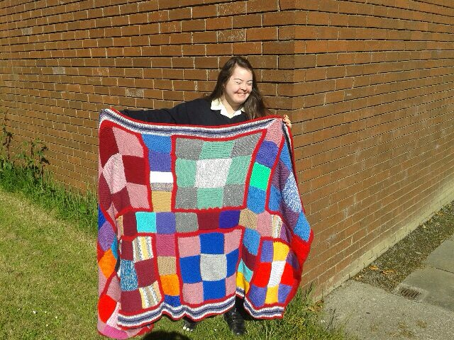Brona OGrady who helped knit this blanket which Ty and 5yr students are bringing out to Zambia in June.