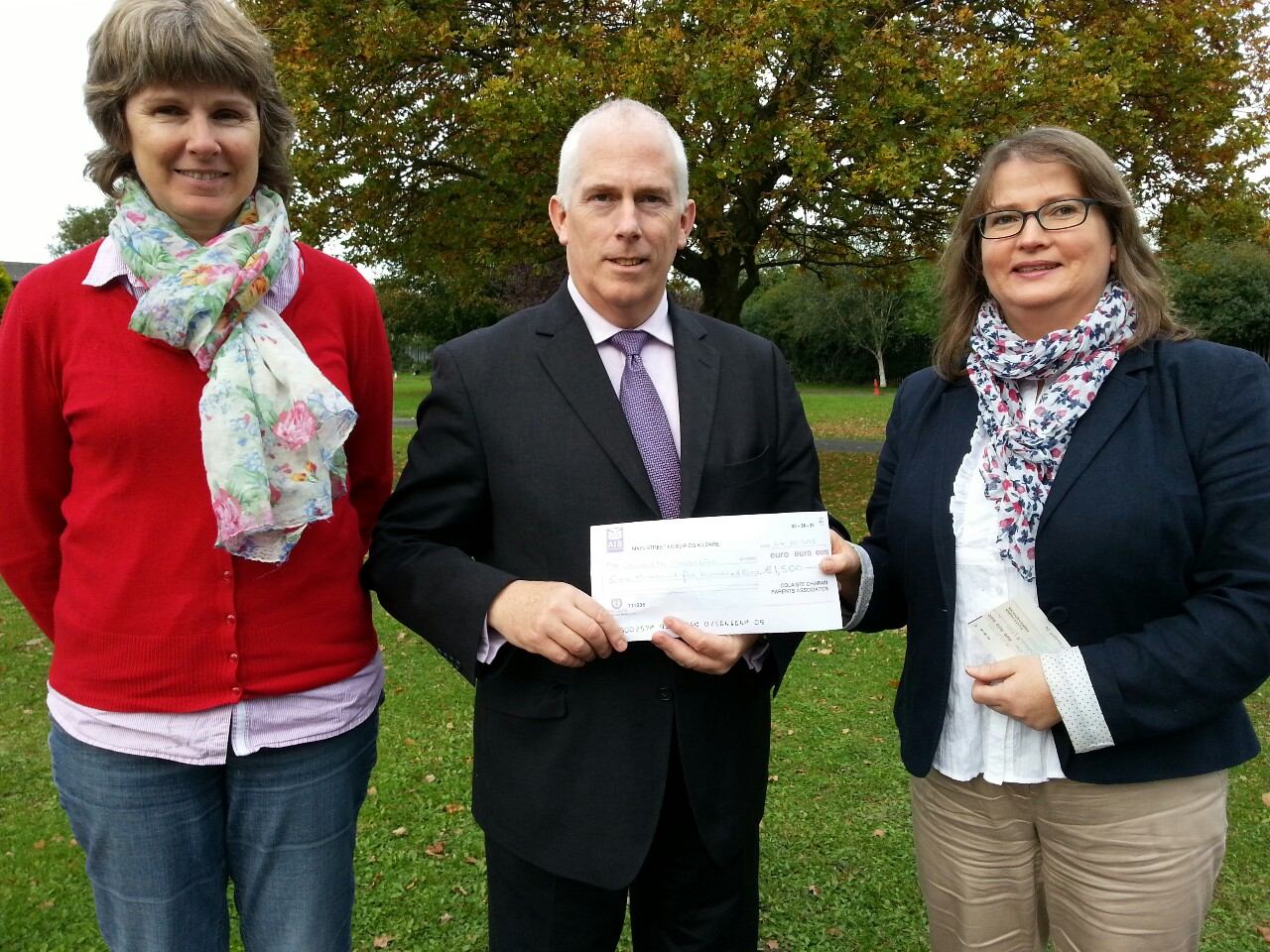Parents Council members Anne Timmins and Claire O'Mahony presenting a cheque for €1500 for the development of the school library to the Principal Joe Sweeney. The money was raised through a number of fund raising initiatives organised by the Parents Council.