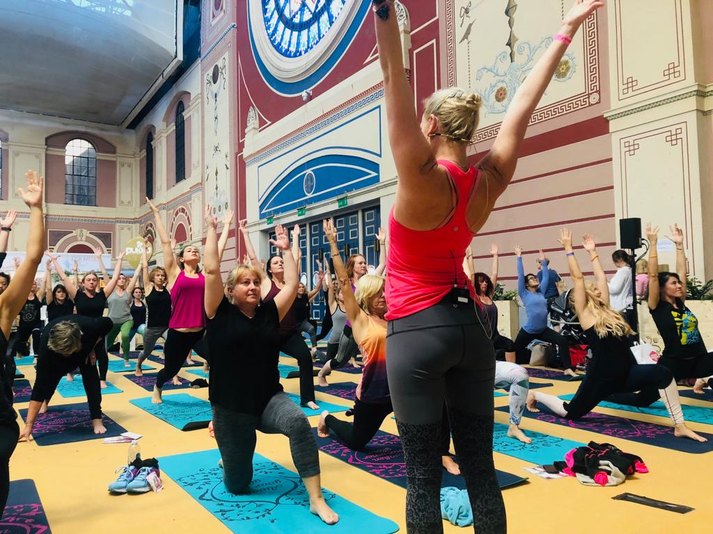 YOGADOO's Bex Bridgford teaches hundreds of yogis over the weekend at the Om show for Pukka Herbs.