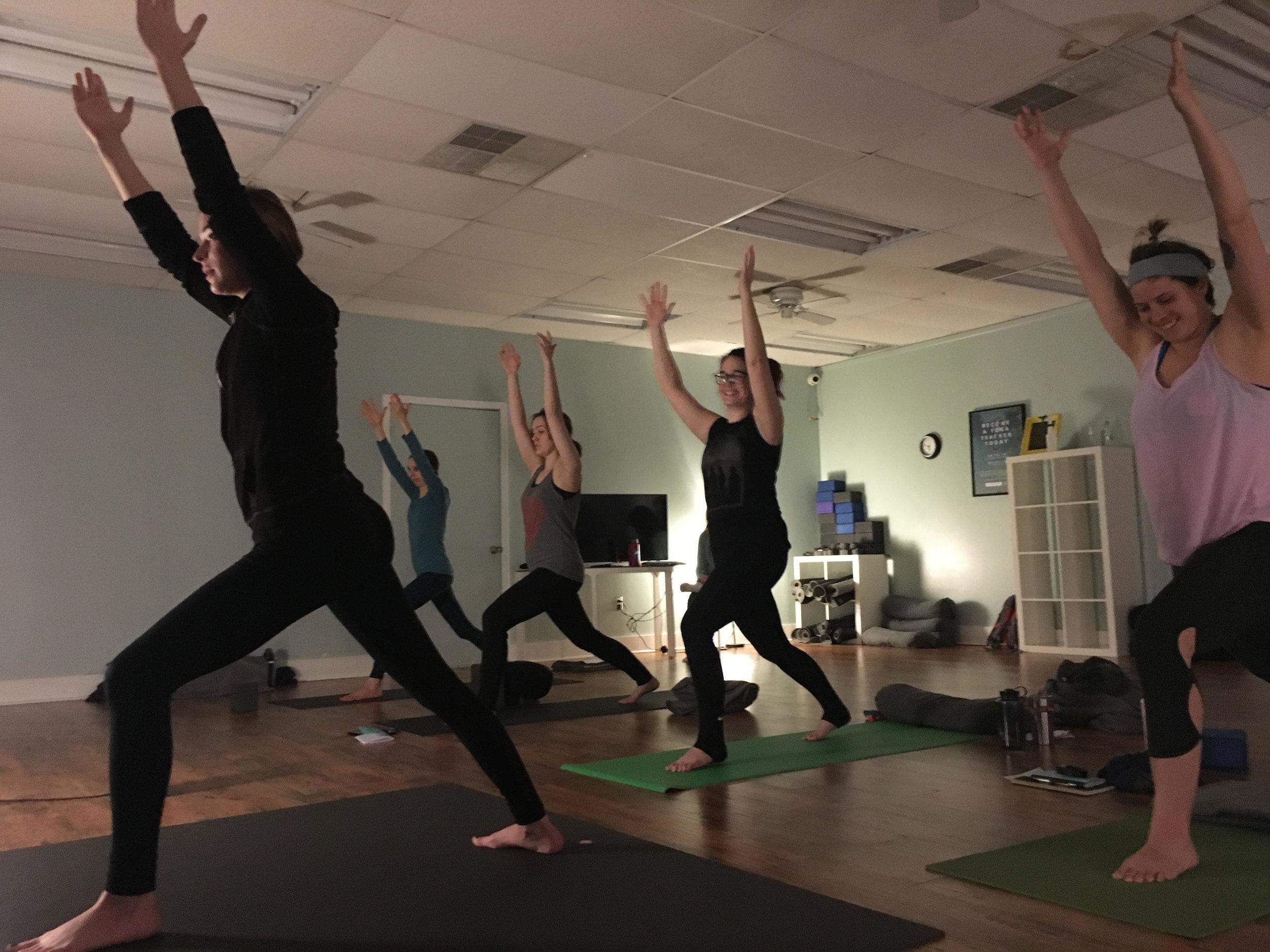 Steph training with her fellow Yoga Teacher trainees.