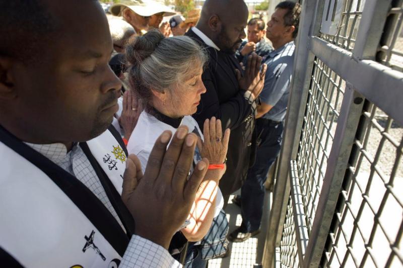 photo praying in front of Otay Mesa.jpg