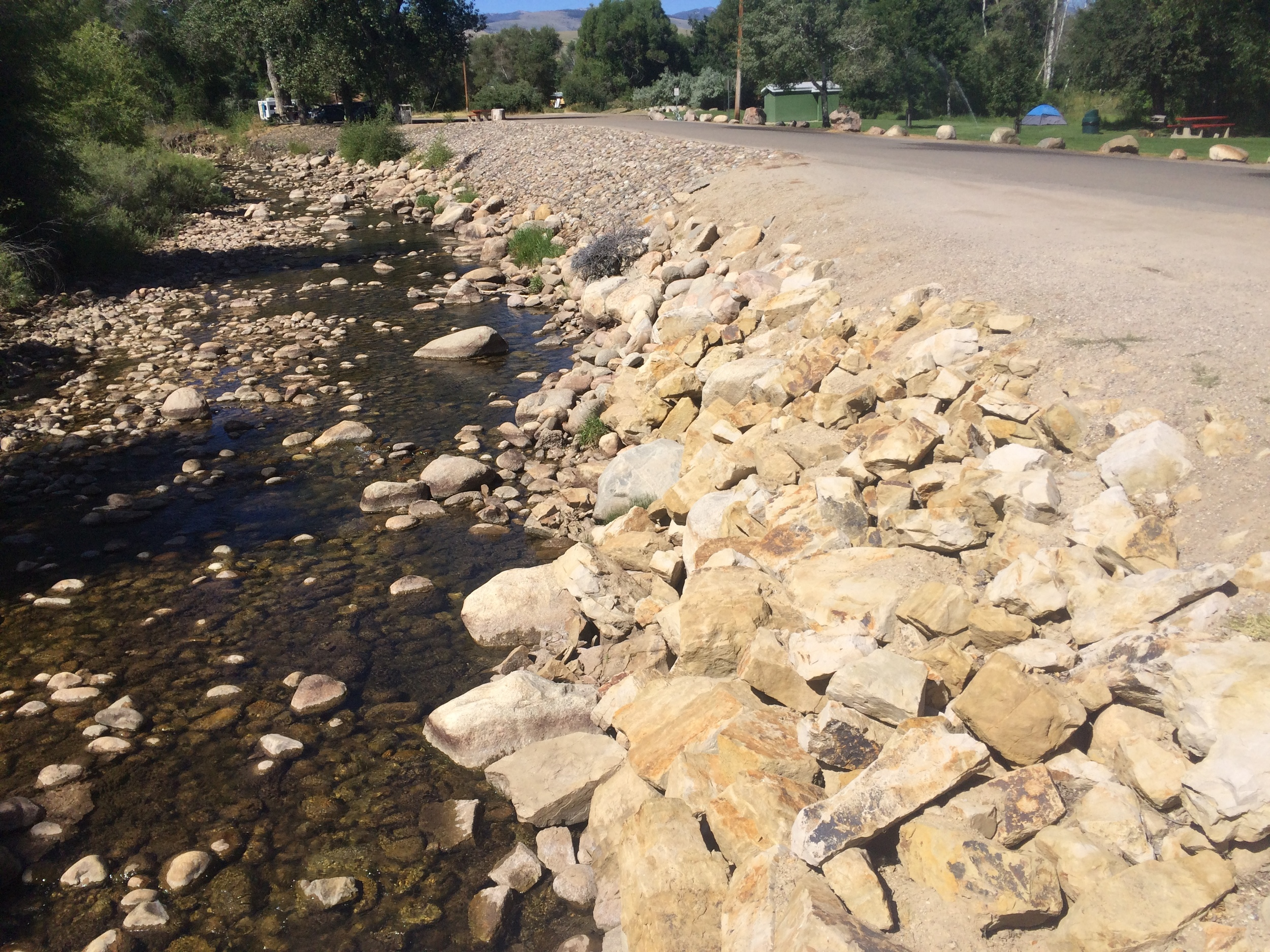 2015 - Post-flood. Rip-rapped banks and a channel with little definition or habitat