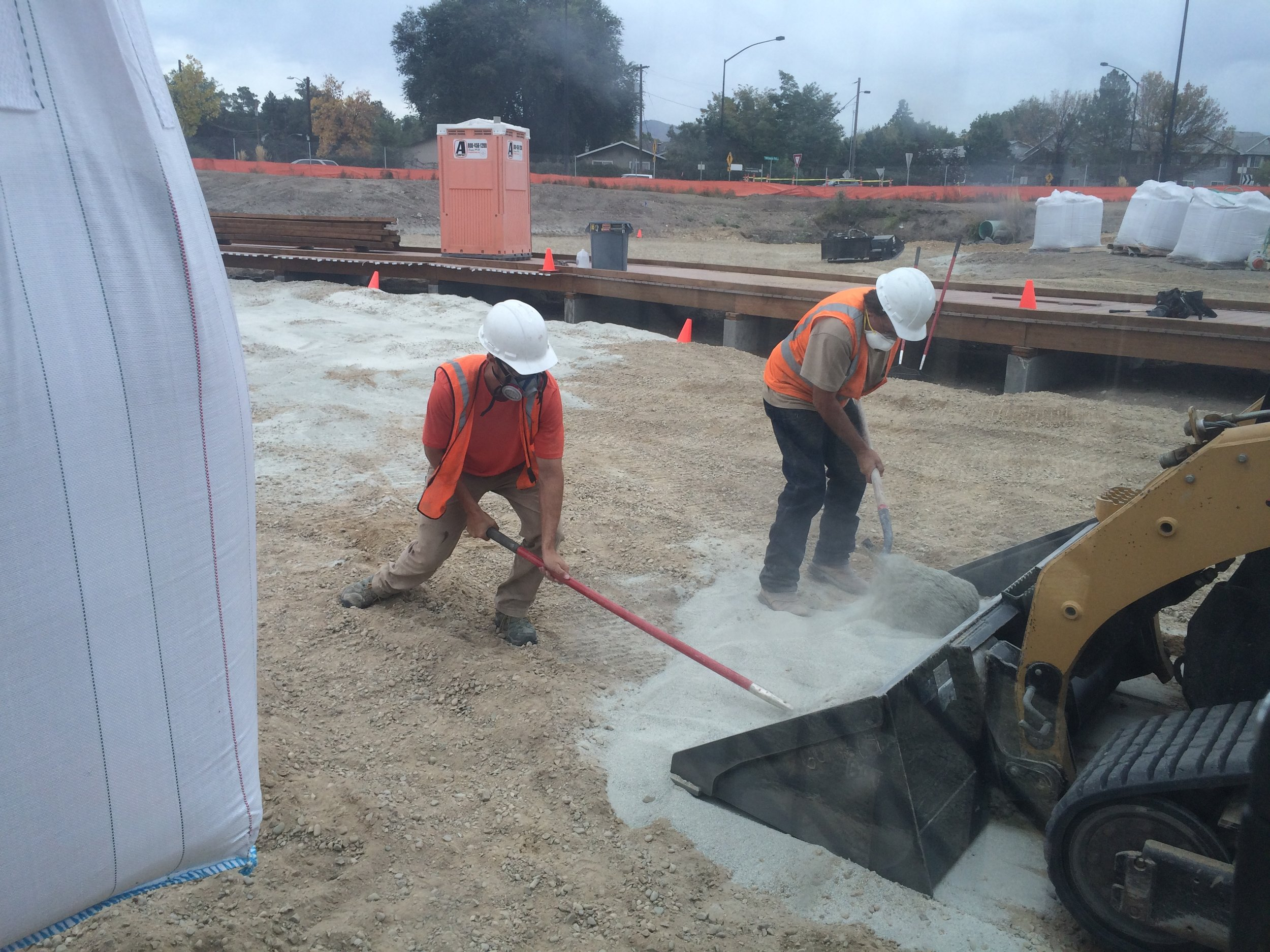 Installing the bentonite liner for water quality areas.