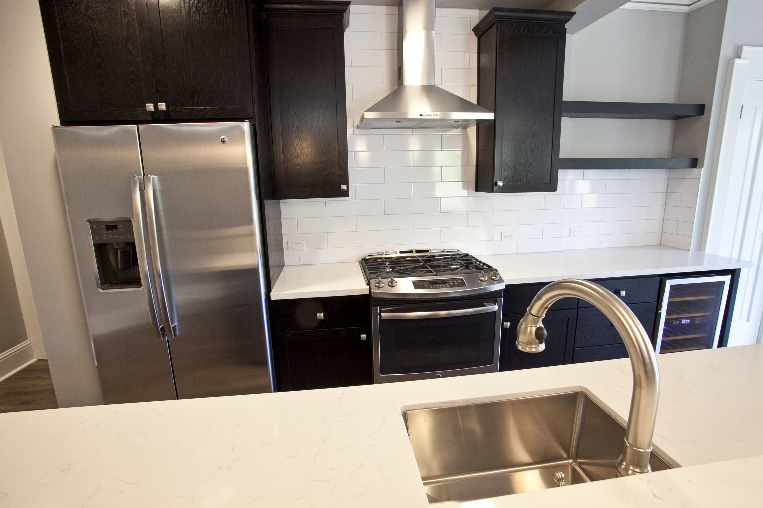 Deep Kitchen Sink with high end faucet - Quartz Counter Tops- Stainless Steel Appliances