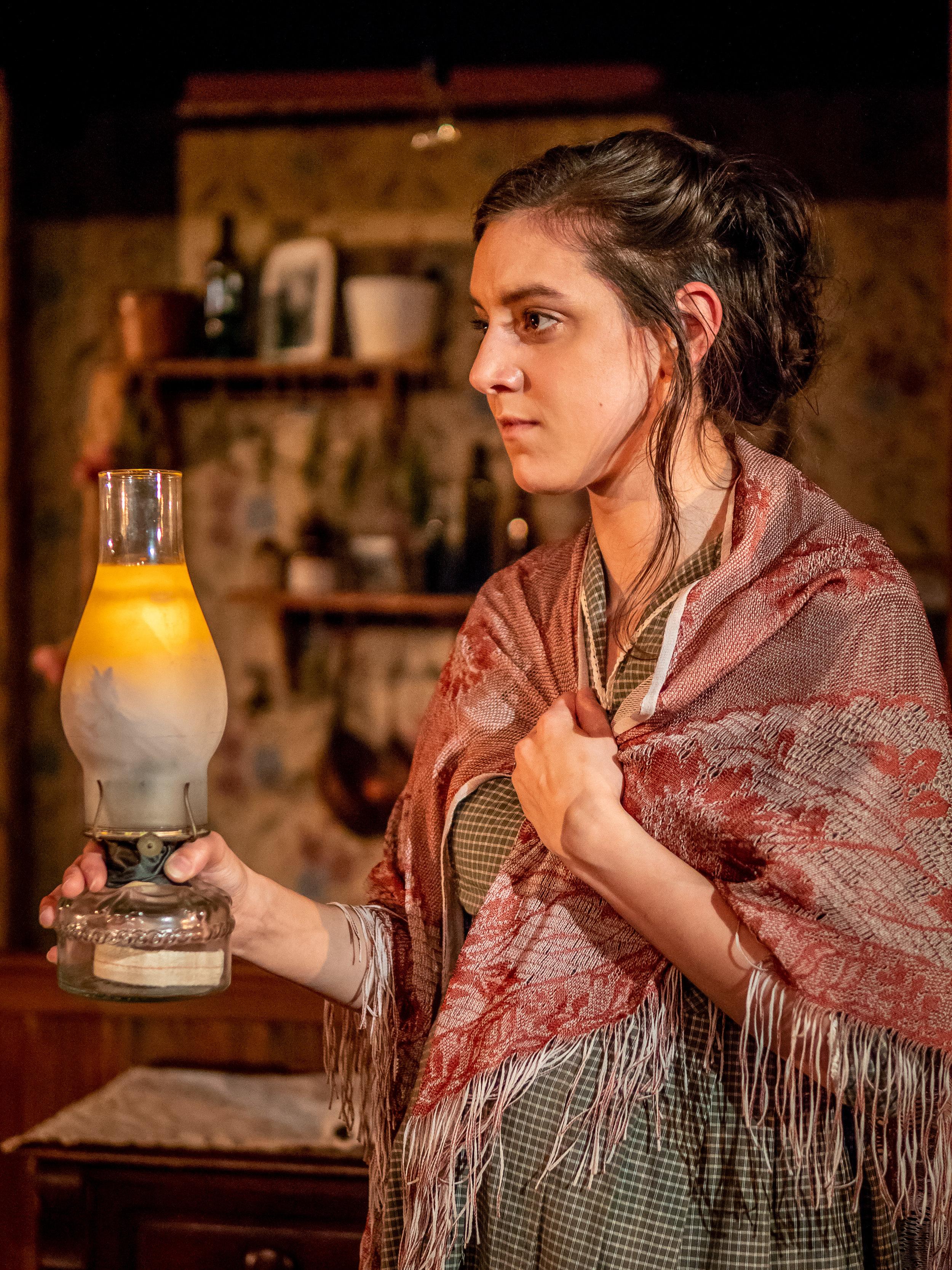 Ewa holds candle black tom.jpg