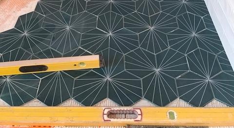 "Fireclay tile, custom 6"" hexagon with screen print used on shower floor."