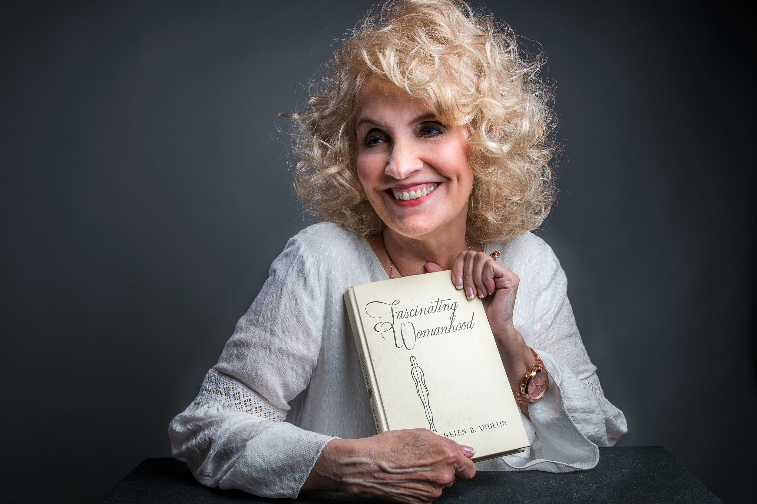 Dixie Andelin Forsyth holding the first copy of the first edition of Fascinating Womanhood, which her mother gave her when they received the first box from the printers in 1963.