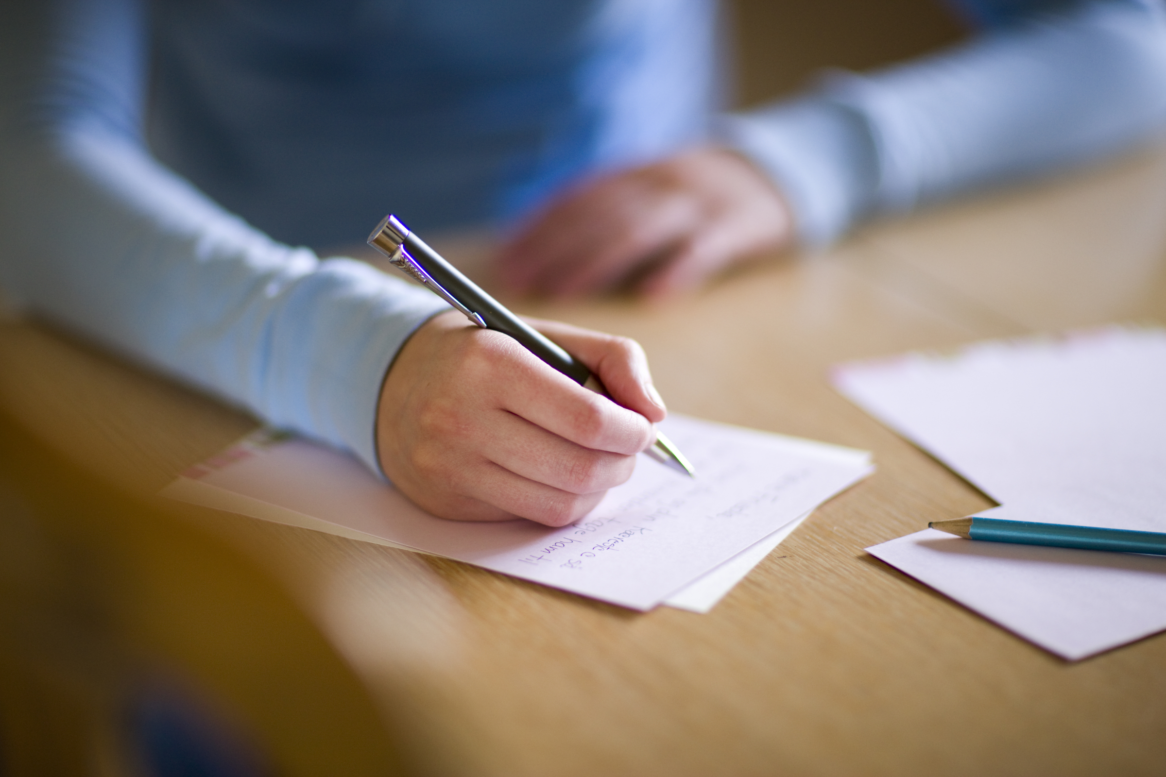 young-woman-writing-letter-693451-wallpaper.jpg
