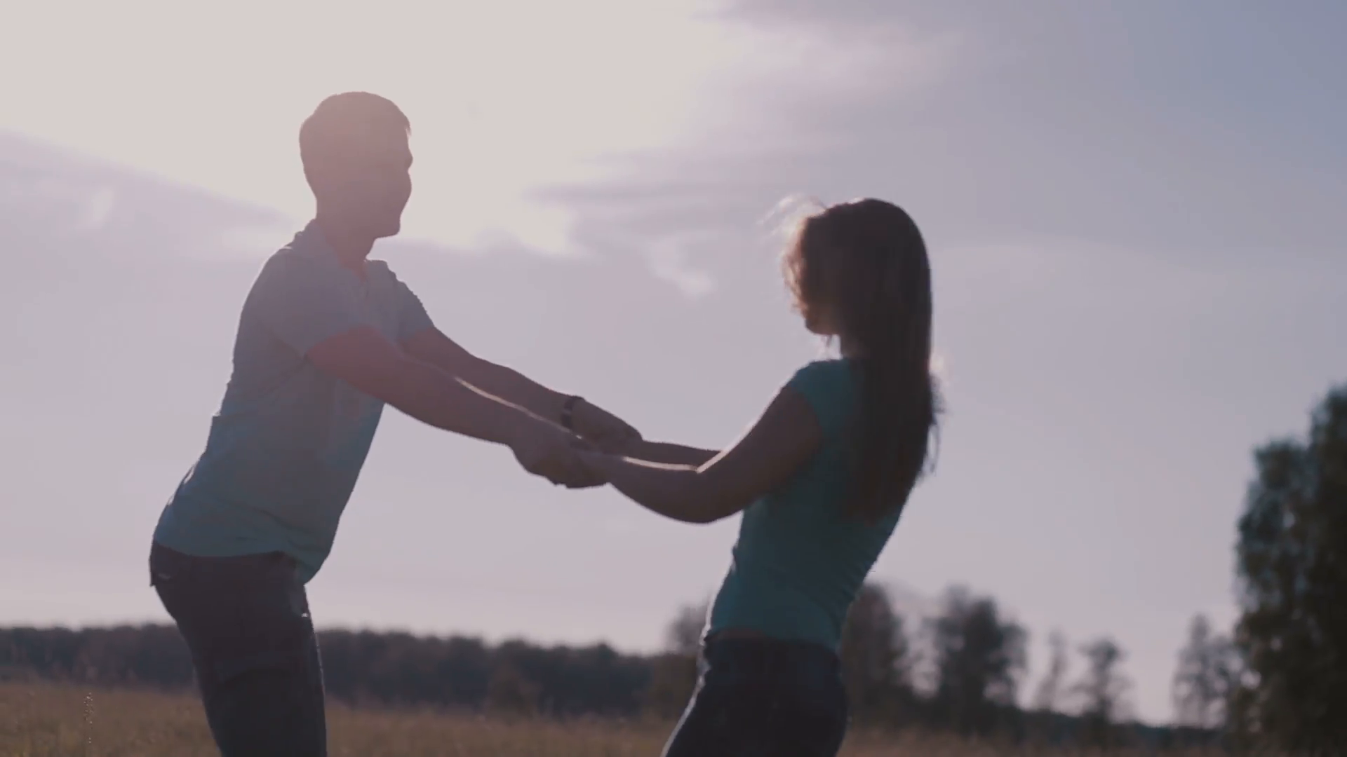 beautiful-couple-holding-hands-in-nature-on-the-field_esejzikckg__F0000.png