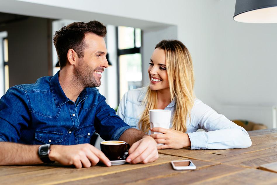 photodune-12654168-happy-couple-talking-at-cafe-s.jpg