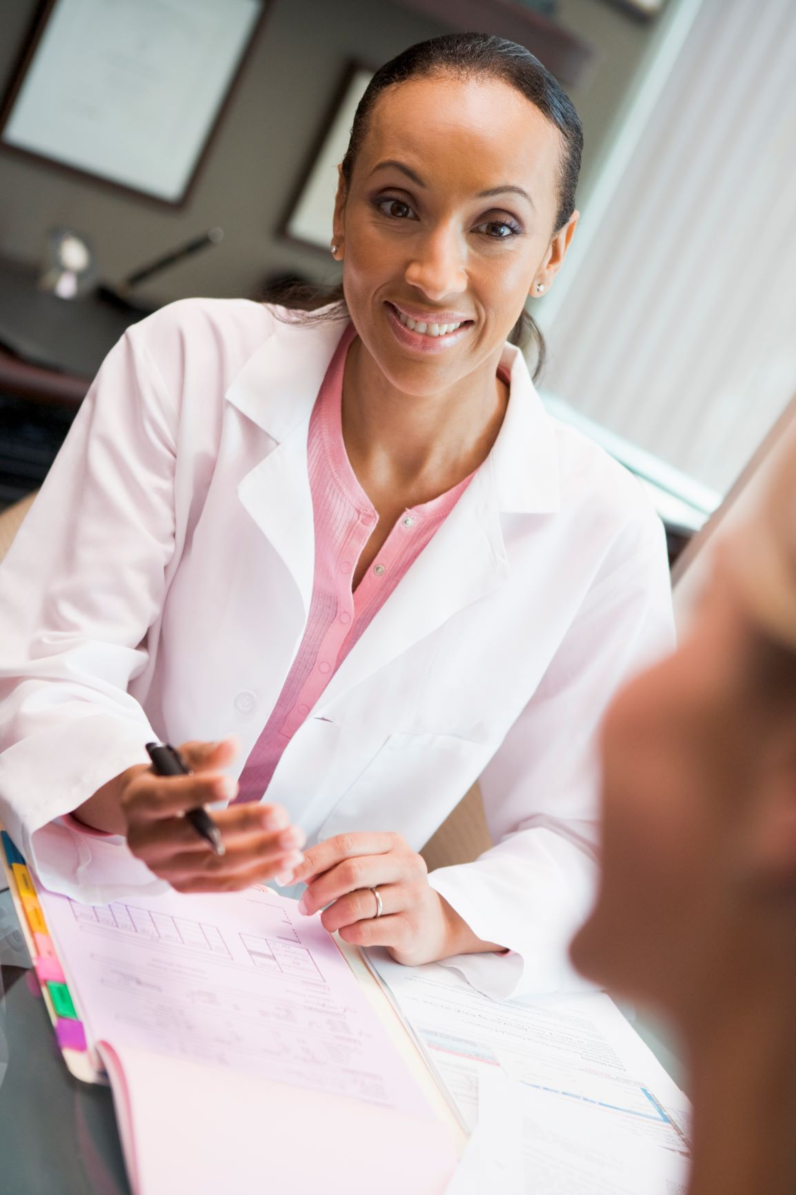 woman-in-discussion-with-patient-in-ivf-clinic-seated-at-desk_HFlj230Bi_smaller.jpg