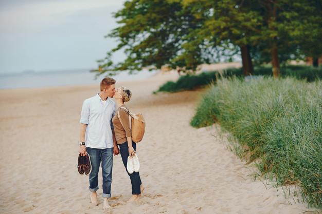 happy-couple-on-a-beach_1157-14783.jpg