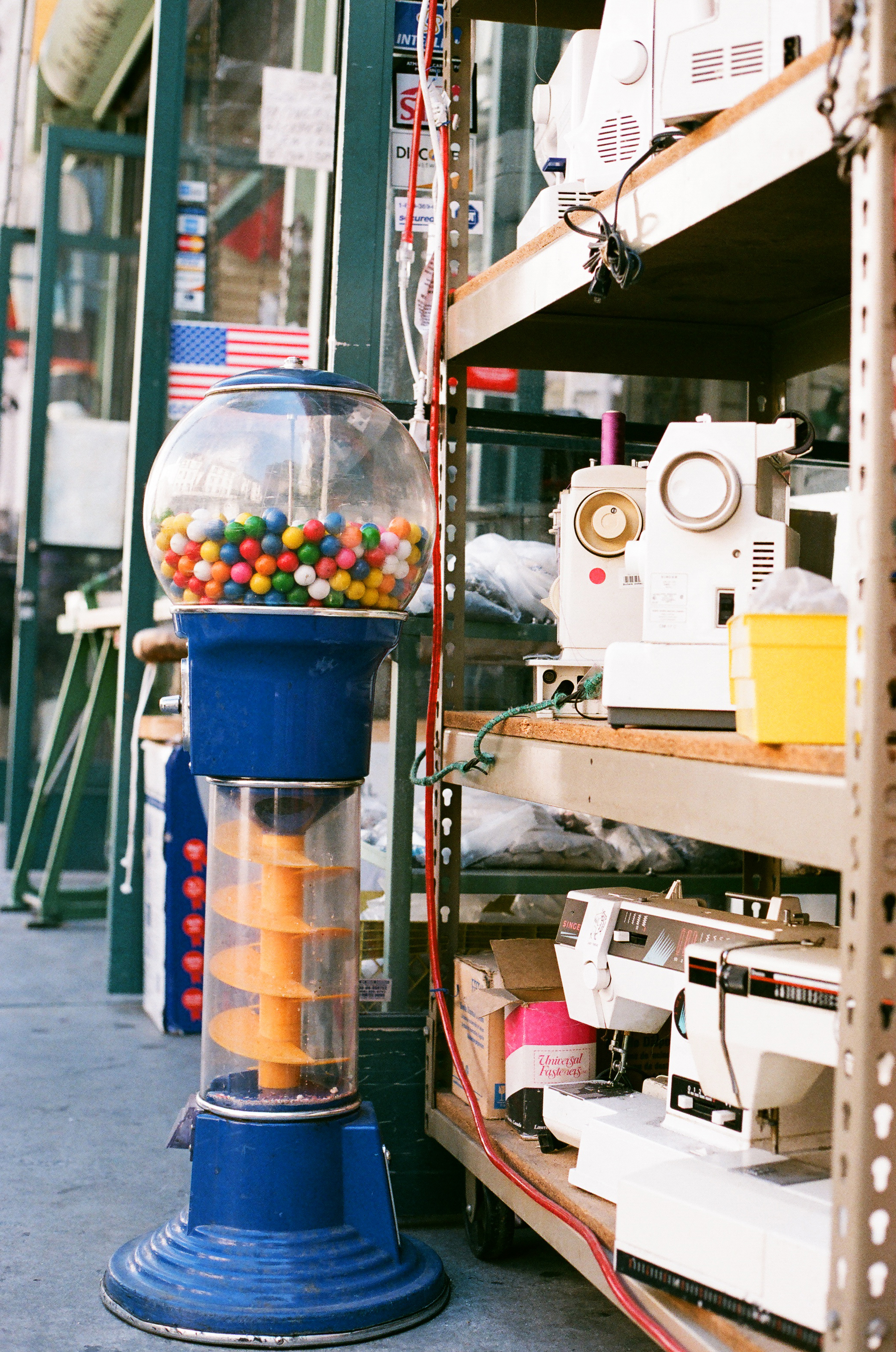 Vintage gum machine at Fashion District sewing machine shop. 35mm