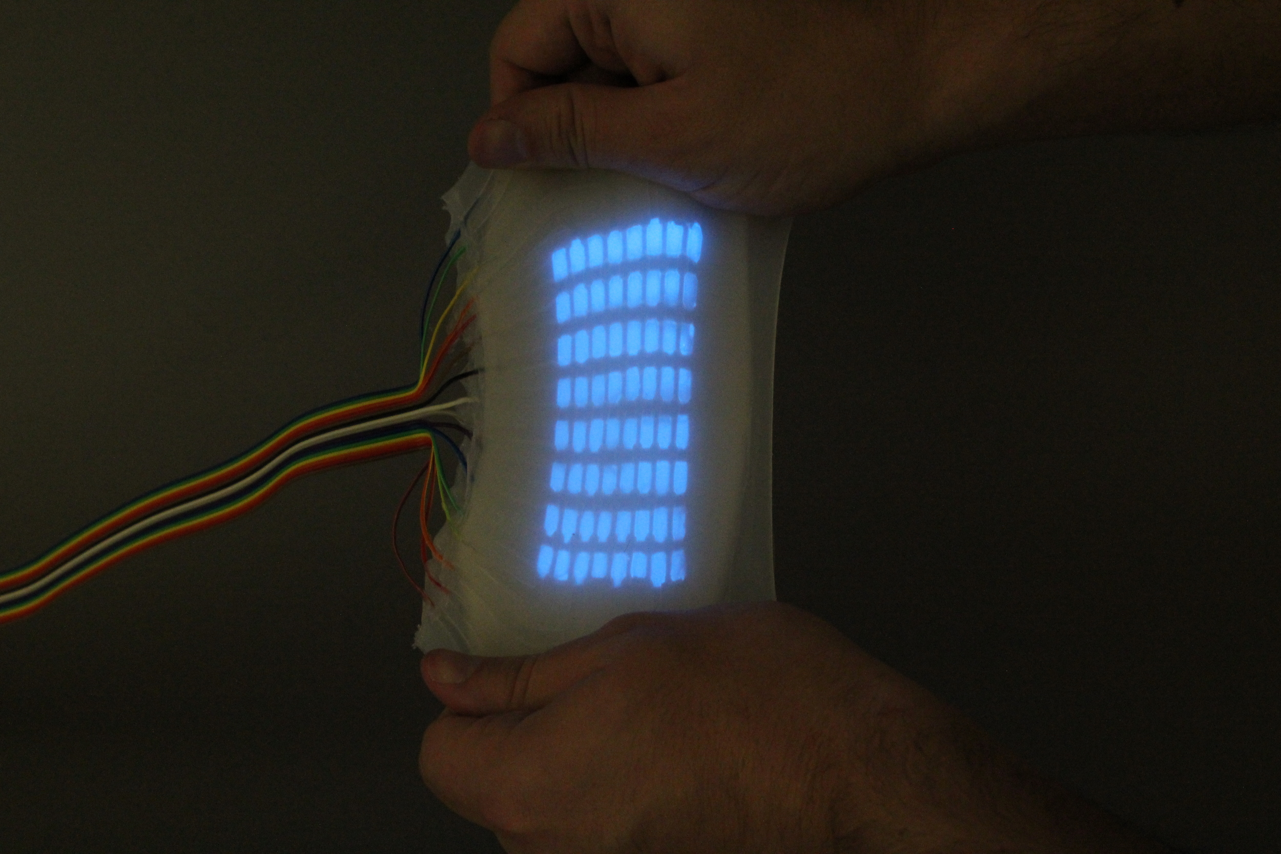 Highly Stretchable Electroluminescent Skin for Optical Signaling andTactile Sensing