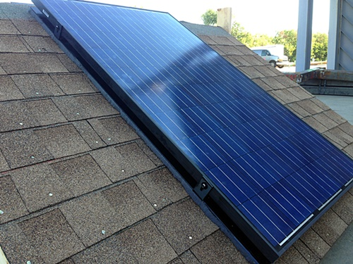 This solar panel is attached to a test roof without penetrations using a cross-linked polymer, an inflammable and relatively lightweight material. The panel can stay attached even in 130-mph winds.