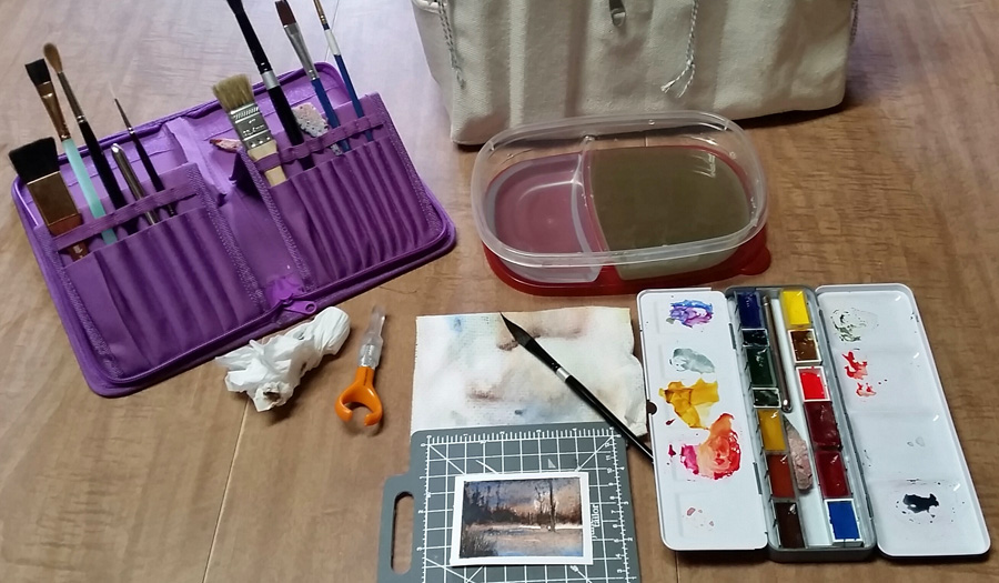 """Fellow artist Bekki willingly shows off her """"studio,"""" which is a portable art bag and her dining room table. Perfect setup!"""