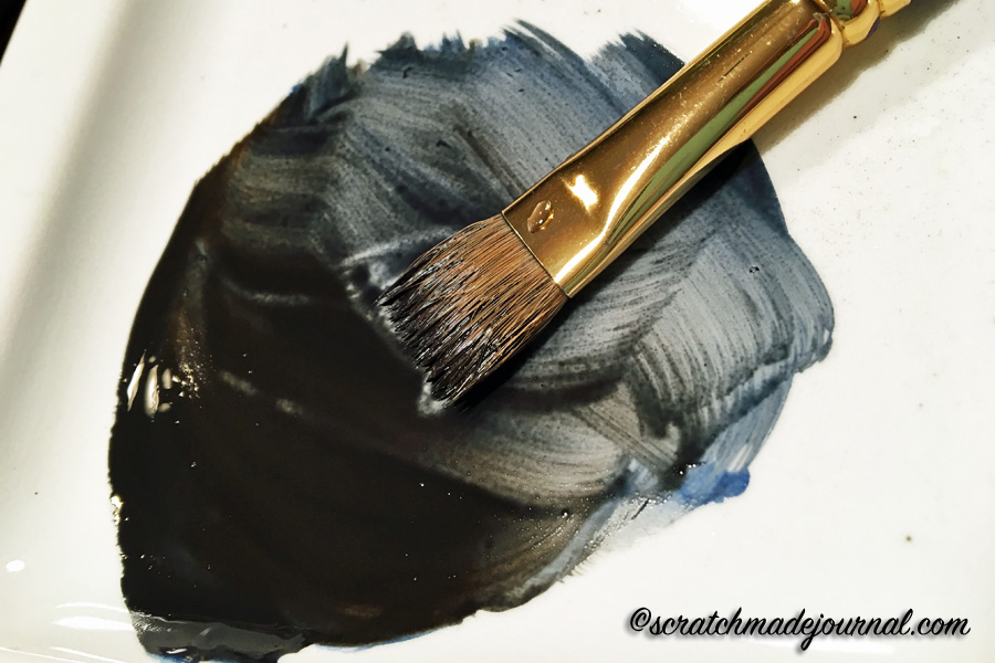 Range of warm to cool blacks when mixing blue and brown.