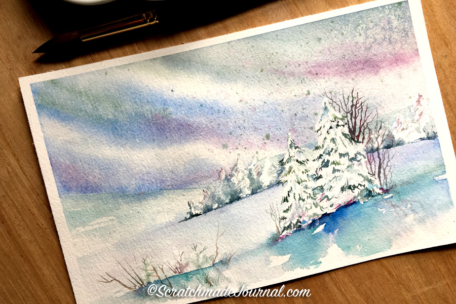 Watercolor tutorial on painting a snowy sky using a salt technique - ScratchmadeJournal.com